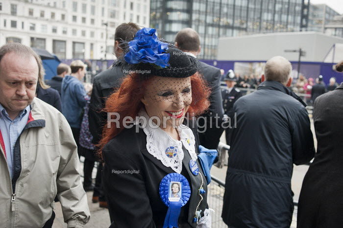 Woman with Iron Lady rosette. Funeral of ex-Prime Minister Margaret Thatcher, City of London - Philip Wolmuth - 2013-04-17