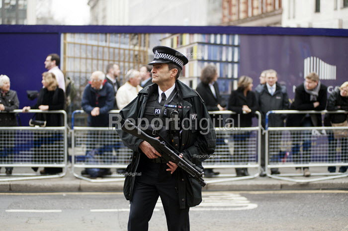 Police officer with a firearm. Funeral of ex-Prime Minister Margaret Thatcher, City of London. - Philip Wolmuth - 2013-04-17