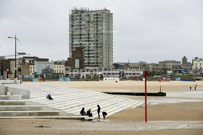 Youth hanging around on the seafront. Arlington House, an eighteen storey 1960s residential apartment block designed by architects Russell Diplock Associates, is a landmark on the Margate seafront. - Philip Wolmuth - 2013-04-16