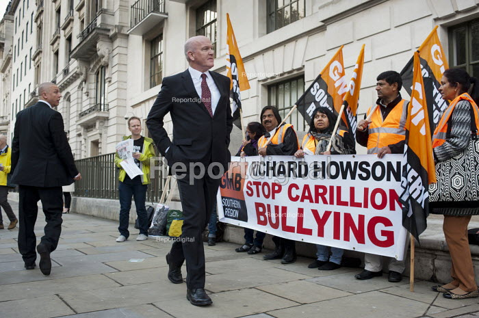 Construction company executives arrive at an awards event at the Royal Institute of British Architecture, London, as ancillary workers from the Great Western Hospital in Swindon, built and managed by Carillion, protest at bullying and blacklisting by the company. Richard Howson is Carillion CEO. - Philip Wolmuth - 2013-05-16