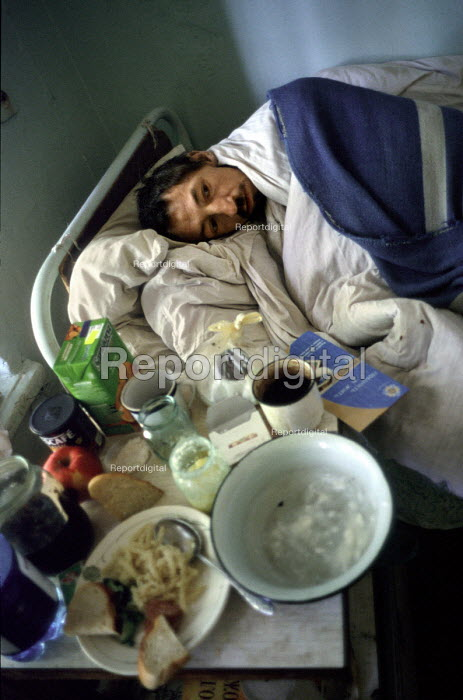 Odessa, Ukraine. A patient at the state-run AIDS Centre on the outskirts of the city. The centre has 25 beds in five dormitories. Patients are locked in to prevent continued drug use. 78.5 of HIV infection in Ukraine is the result of intravenous drug use. - Philip Wolmuth - 2001-05-16