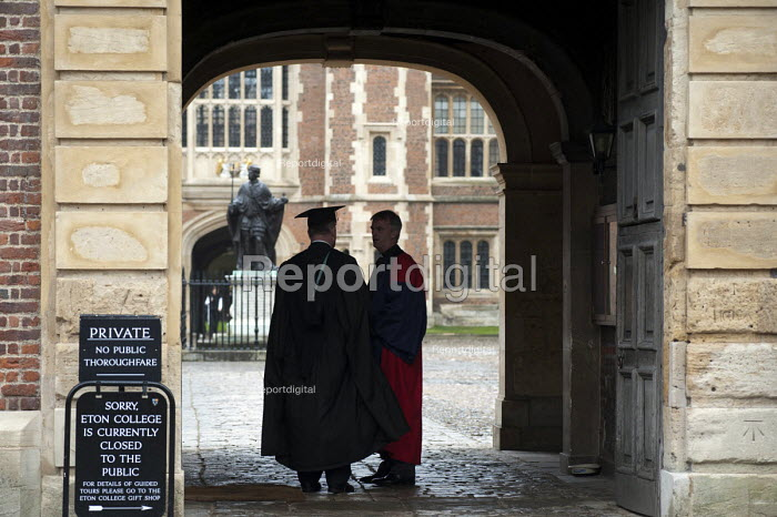 Two teachers in gowns at the entrance to Eton College. - Philip Wolmuth - 2013-05-29