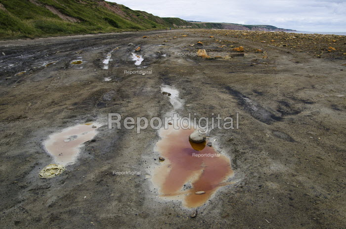 A pool of polluted water on the beach at Easington Colliery, County Durham. The beach was used to dump coal waste until the pit close in 1993. Pollution persists despite a subsequent clean-up programme. - Philip Wolmuth - 2013-08-10
