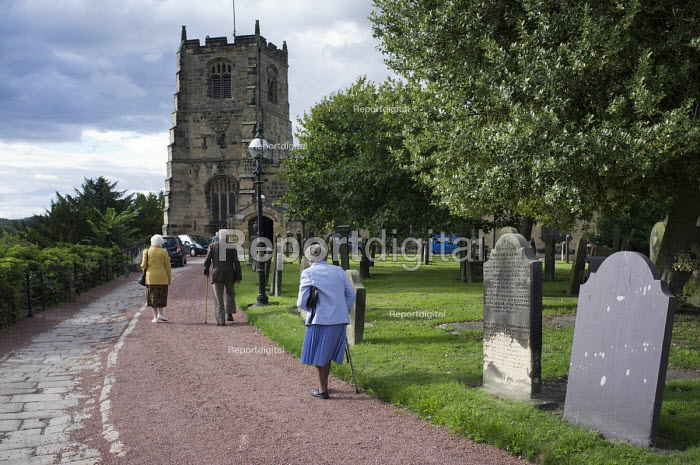 Elderly worshippers arrive for a Sunday evening service at St. Michael's Church in Alnwick, Northumberland. - Philip Wolmuth - 2013-08-11