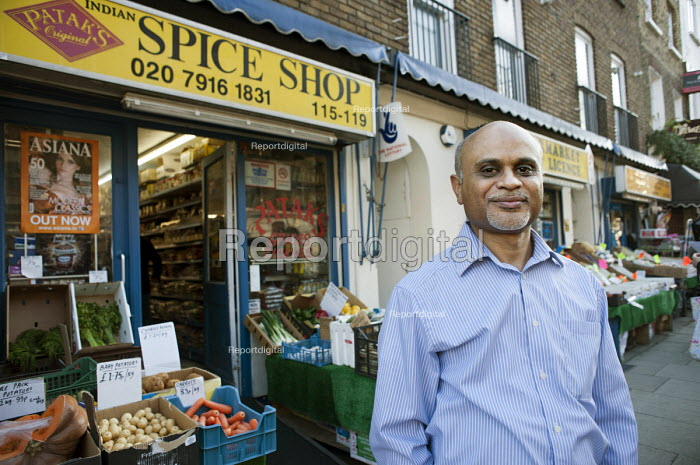 Arsat Baguaty outside his grocery shop in Drummond Street, Euston.. The street is noted for its thriving Bangladeshi restaurants, but its future is threatened by the HS2 high-speed rail development. - Philip Wolmuth - 2012-02-23