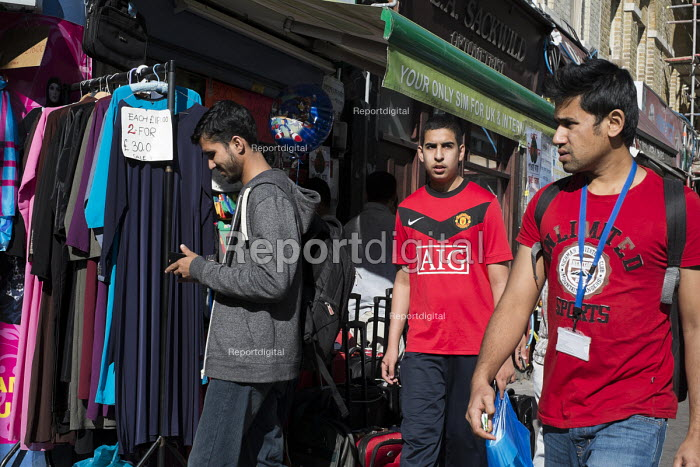 Pedestrians in Whitechapel High Street. The area is home to the largest Muslim community in the UK. - Philip Wolmuth - 2013-09-02