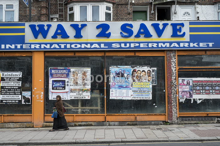 Closed way 2 save supermarket with posters advertising entertainment, West Hendon, London. - Philip Wolmuth - 2013-09-12