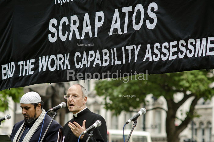 David Ison, Dean of St.Paul's Cathedral and Mohammed Ansar. 10,000 Cuts and Counting memorial service in Parliament Square, London, to commemorate those who have died shortly after undergoing a Work Capability Assessment by government contractor Atos. - Philip Wolmuth - 2013-09-28