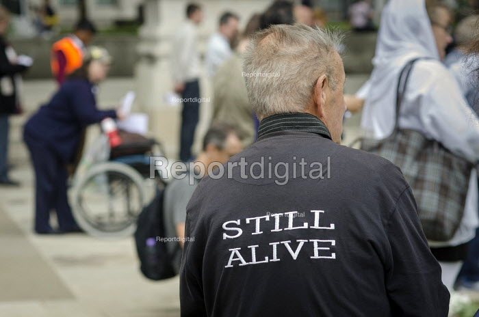 10,000 Cuts and Counting memorial service in Parliament Square, London, to commemorate those who have died shortly after undergoing a Work Capability Assessment by government contractor Atos. - Philip Wolmuth - 2013-09-28