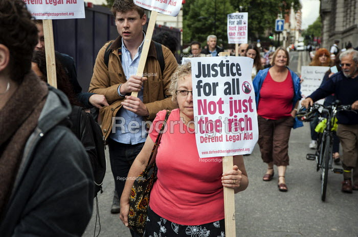 UK Uncut and Disabled People Against the Cuts march to the Royal Courts of Justice in protest at proposed cuts to Legal Aid. - Philip Wolmuth - 2013-10-05