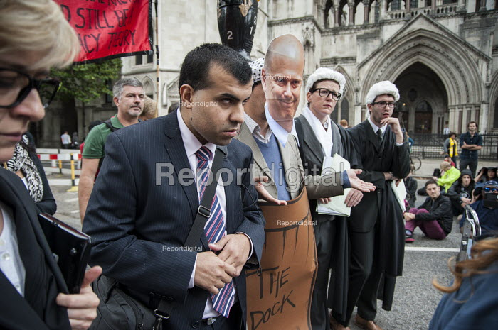A disabled witness gives evidence at a mock trial of Justice Minister Chris Grayling. UK Uncut and Disabled People Against the Cuts block the road outside the Royal Courts of Justice in protest at proposed cuts to Legal Aid. - Philip Wolmuth - 2013-10-05