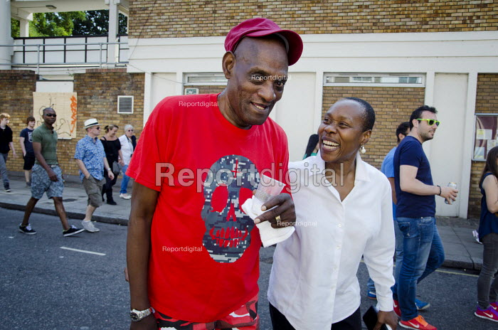 Darcus Howe, writer, broadcaster and campaigner, at Notting Hill carnival with the Mangrove carnival band, of which he was a founder member, and Claire Holder, a past CEO of the Notting Hill Carnival Trust. - Philip Wolmuth - 2013-08-26