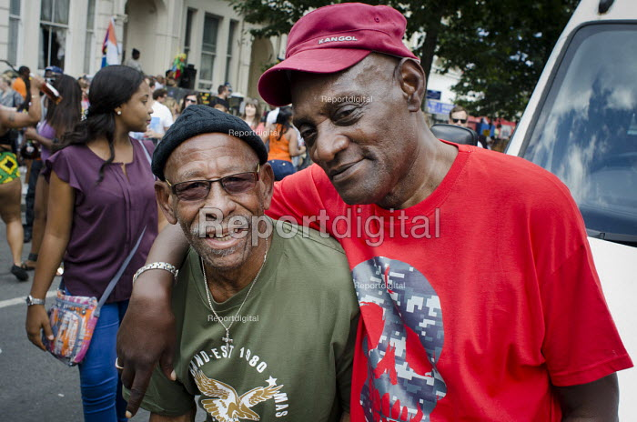 Darcus Howe, writer, broadcaster and campaigner, at Notting Hill carnival with the Mangrove carnival band, of which he was a founder member. - Philip Wolmuth - 2013-08-26