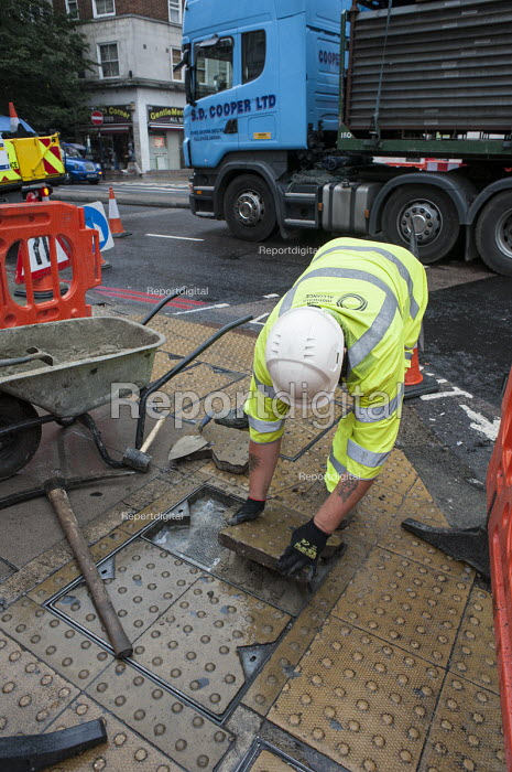 A London Highways Alliance pavement repair team at work on a Clean Up Day organised by Edgware Road Partnership. - Philip Wolmuth - 2013-09-19