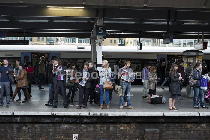 Commuters waiting on a platform at London Bridge station. - Philip Wolmuth - 2013-09-20
