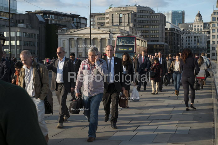 City workers cross London Bridge during the evening rush hour. - Philip Wolmuth - 2013-09-20