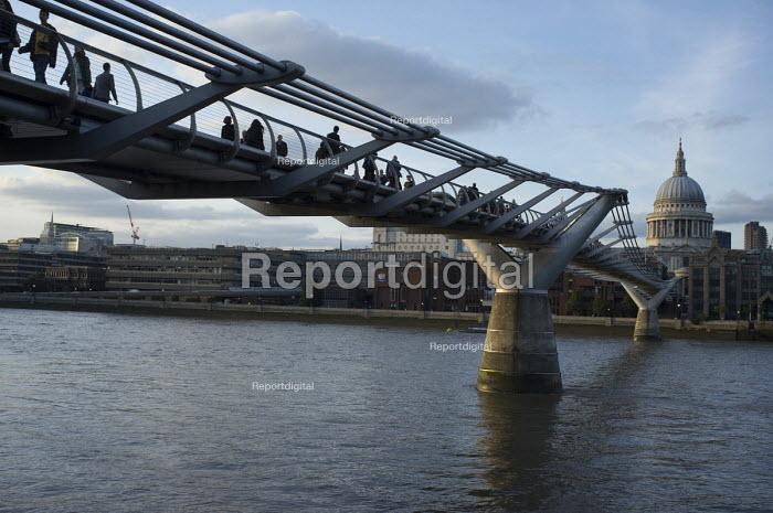 Pedestrians cross the Millennium Bridge across the River Thames, London. - Philip Wolmuth - 2013-09-20