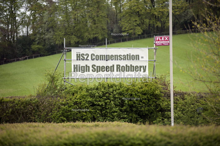 HS2 Compensation = High Speed Robbery. Roadside banner near Great Missenden, Buckinghamshire, close to the proposed route of the HS2 high speed rail line. - Philip Wolmuth - 2014-04-23