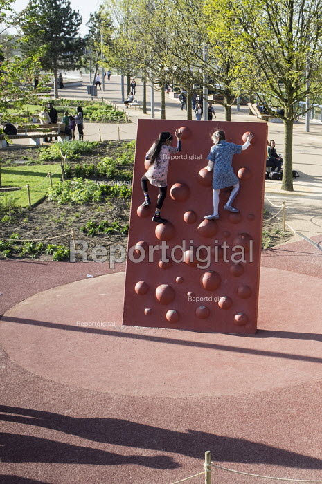 Two girls on a climbing wall at the Queen Elizabeth Olympic Park, Stratford. - Philip Wolmuth - 2014-04-15