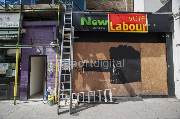 Now Vote Labour. Work in progress on a boarded-up shop in Camden, London. - Philip Wolmuth - 2014-05-14