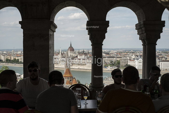The Hungarian Parliament building in Pest, seen from a bar on the Buda side of the Danube, Budapest. - Philip Wolmuth - 2014-06-29
