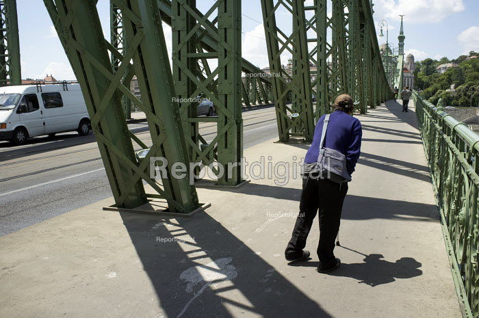 A disabled man with a walking stick begging on the Lanchid bridge over the river Danube, Budapest. - Philip Wolmuth - 2014-07-01