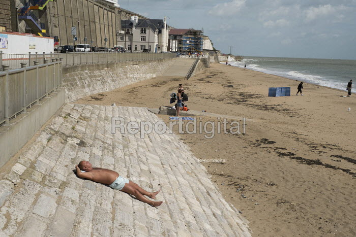 A solitary sun-bather on the beach in high season in Ramsgate, one of the five most deprived seaside towns in the UK. - Philip Wolmuth - 2014-08-12