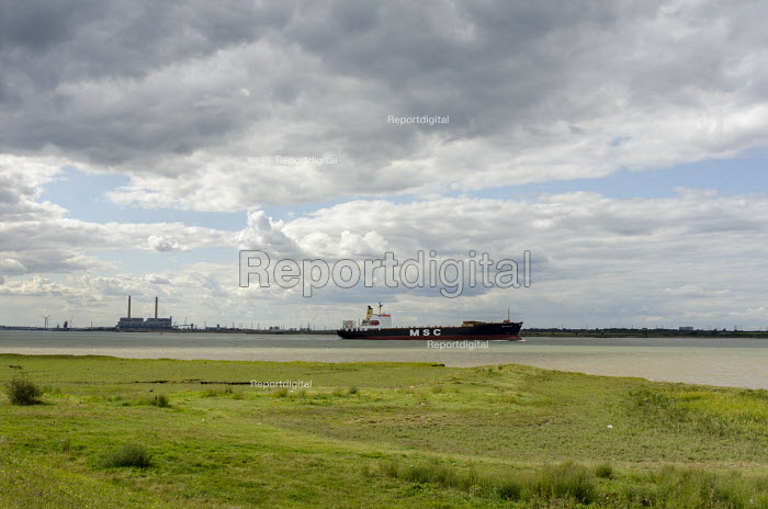 A merchant ship in the Thames estuary close to Tilbury Power Station. - Philip Wolmuth - 2014-08-23