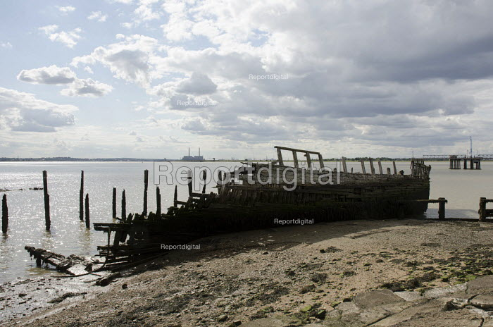 Decaying wooden hull of a ship at a disused dock on the Kent shore of the Thames estuary. - Philip Wolmuth - 2014-08-23