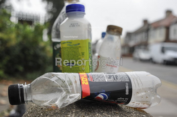 An assortment of plastic bottles on a wall on a London street. - Philip Wolmuth - 2014-09-17