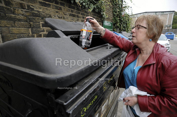 Residents recycle plastic bottles at Park View recycling centre, Haringey, London - Philip Wolmuth - 2014-09-17