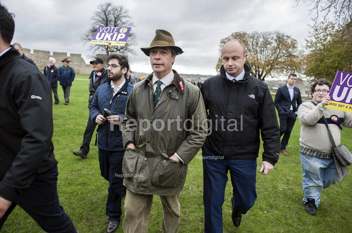 Nigel Farage escorted by security after disruption by SWP. UKIP leader Nigel Farage and ex-Conservative MP Mark Reckless, the UKIP candidate, canvas in Rochester before the Rochester and Strood by-election. - Philip Wolmuth - 2014-11-08