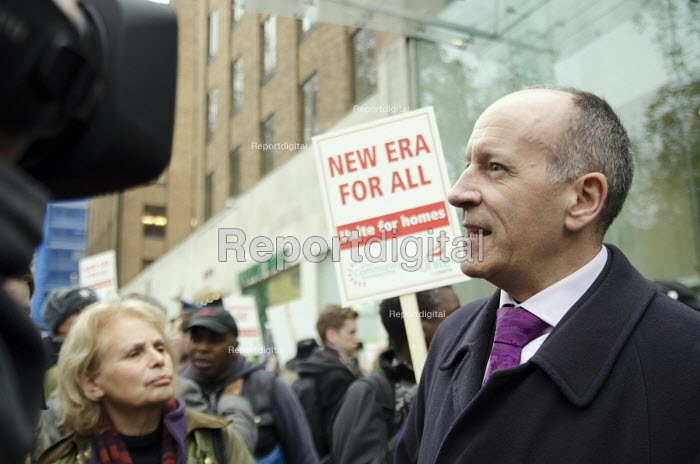 Mayor of Hackney Jules Pipe gives a TV interview as residents of the New Era Estate in Hoxton protest at proposed rent rises outside the Mayfair office of US property company Westbrook Partners. - Philip Wolmuth - 2014-12-01