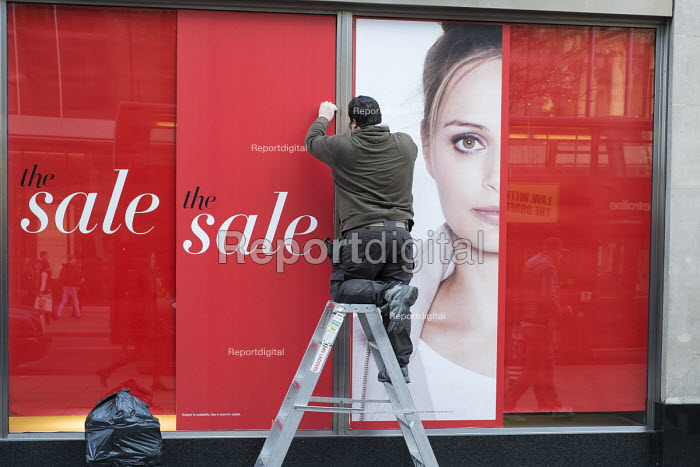 Window cleaner. January sale at a Marks & Spencer store, Oxford Street, London. - Philip Wolmuth - 2015-01-02