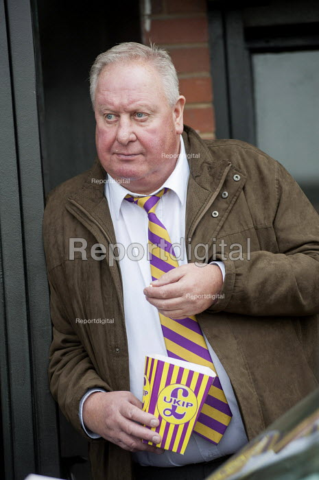 A local UKIP supporter eating UKIP popcorn outside the Movie Starr cinema, Canvey Island, South Essex, following the launch of the party's General Election campaign. - Philip Wolmuth - 2015-02-12