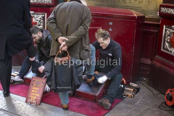 Two men shining shoes in Leadenhall Market, close to the Lloyds Bulding and other major City of London financial institutions. - Philip Wolmuth - 2015-02-17