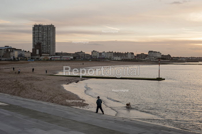 Margate beach and landmark Arlington House flats on the seafront. Like many other once popular UK seaside resorts, the town has suffered serious economic decline - Philip Wolmuth - 2015-02-27