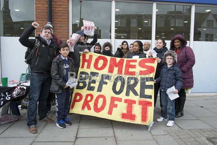 Homes before Profit. Housing campaigners and former residents of the Sweets Way estate in Whetstone, Barnet, London, hand out leaflets in Whetstone to demand rehousing closer to schools, family and friends. Many former tenants are now living in emergency accommodation outside the borough following evictions in advance of demolition and redevelopment by Annington, a subsidiary of private equity investors Terra Firma. - Philip Wolmuth - 2015-03-21