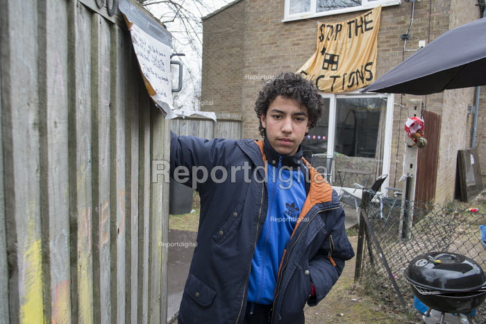Abdou Guernaoui (aged 14) at a house occupied by housing campaigners on the Sweets Way estate in Whetstone, Barnet, London. His family was evicted from their former home on the estate and placed in emergency accommodation outside the borough in February. Abdou now has to travel up to 2 hours each way to school and evening football practice sessions. The evictions took place in advance of proposed demolition and redevelopment by Annington, a subsidiary of private equity investors Terra Firma. - Philip Wolmuth - 2015-03-21