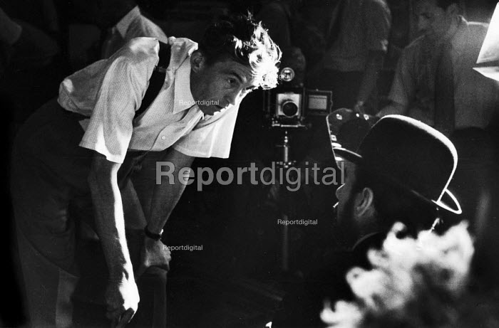 Film Director John Huston on the set of Moulin Rouge 1952 with actor Jose Ferrer in the role of Toulouse Lautrec, Paris, France - Elizabeth Chat - 1952-07-08