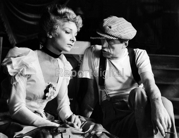 Film Director John Huston talking to Colette Marchand on the set of Moulin Rouge 1952, Paris, France - Elizabeth Chat - 1952-07-08