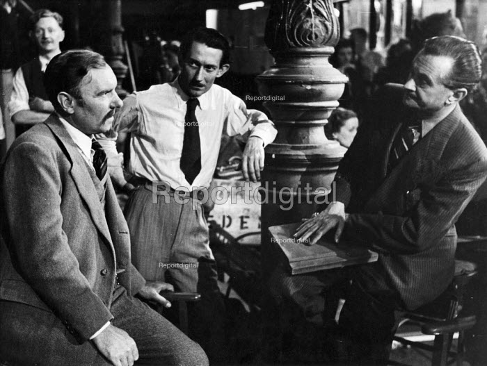 Film set of Anna Karenina, directed by Julien Duvivier, right, talking to actor, Ralph Pichardson on right, London, 1947. - Felix H. Man - 1947-07-19