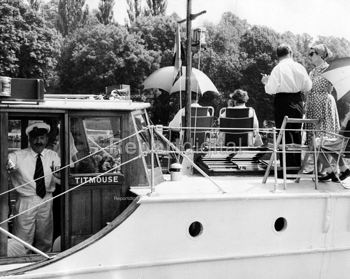 The idle rich at play aboard a small private yacht called Titmouse at the Henley Regatta in an early 1950s summer. .... - Felix H. Man - 1951-07-04