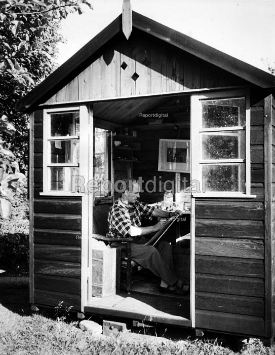 Sculptor, Henry Moore, drawing undisturbed in his small hut in his garden at his open air studio in Much Hadham, Hertfordshire in the early to mid 1950s. The hut was built on a turntable so that Moore could position it as he wanted in relation to the position of the sun during the day. .... - Felix H. Man - 1953-05-11