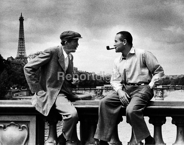 Film Director John Huston (L) taking a break from the production of Moulin Rouge 1952, Paris, France - Ina Bandy - 1952-07-08