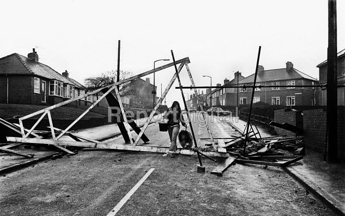 A woman walking her dog through South Elmsall village the night after a riot ensued following police attempts to get one scab miner through an NUM picket line and into work at Frickley Pit. Miners strike - John Harris - 1984-11-15