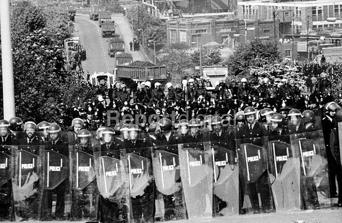 Massed ranks of police prevent striking miners from picketing lorries leaving the plant, mass picket, Orgreave coking plant, miners' strike - John Harris - 1984-05-28