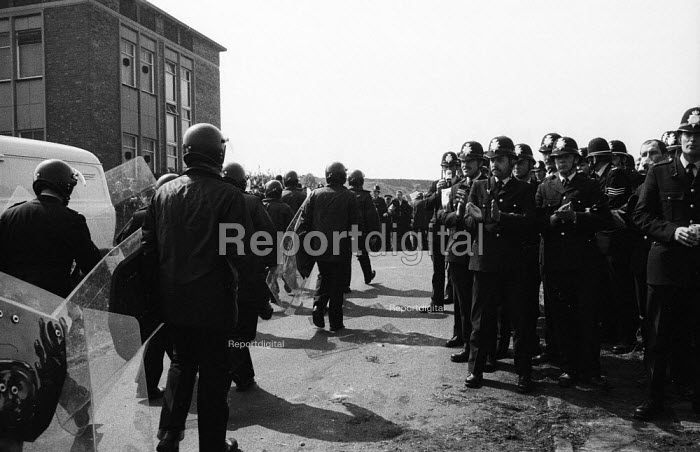 Police officers applauding riot police as they return from attacking the mass picket, Orgreave coking plant, miners strike Yorkshire - John Harris - 1984-05-28