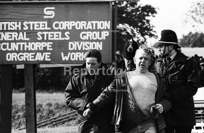 Police officer arresting a striking miner, mass picket, Orgreave coking plant, Yorkshire, Miners Strike - John Harris - 1984-05-28