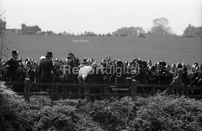 Striking miners and massed ranks of police officres during a mass picket of the Orgreave coking plant during the miners' strike - John Harris - 1984-05-29